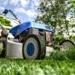 blue and grey lawn mower on a lawn