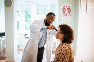 Woman gets an ear exam.